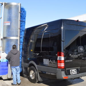 bus wash machine. Bitimec Wash-bots battery powered 626-EZ bus washing machine washing a Mercedes sprinter van at AJL in Dallas