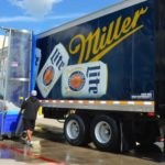 Bitimec wash-bots battery powered 626-EZ truck & trailer washing machine washing a Miller Light Trailer